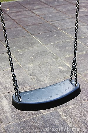 Empty swing on the playground, isolated