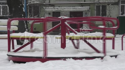 Empty swing in winter yard. Urban scene building background stock video footage