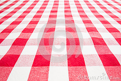 Empty table covered by red gingham tablecloth