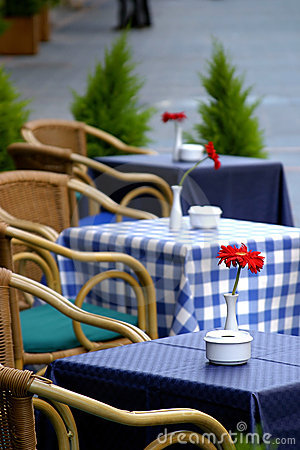 Free Empty Tables On The Street With Roses On Them Outside A Cafe Bar Or Restaurant . Stock Photography - 125522