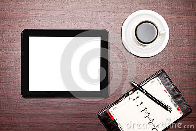 Empty tablet and a cup of coffee in office