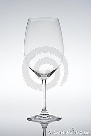Empty vine glass on gradient background