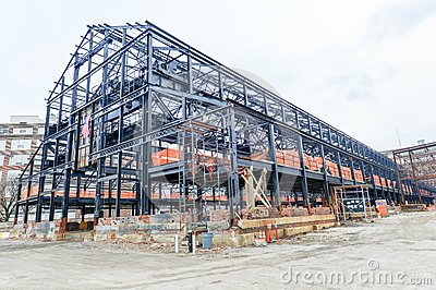 Empty warehouse/factory shell under construction.