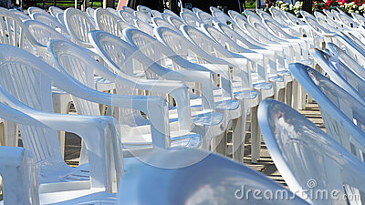 Empty white chairs