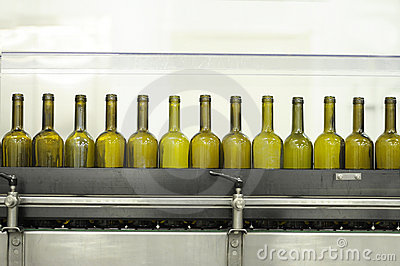 Empty wine bottles on a filling line