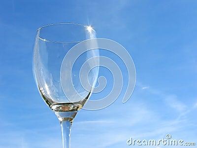Empty wineglass on sky backgro