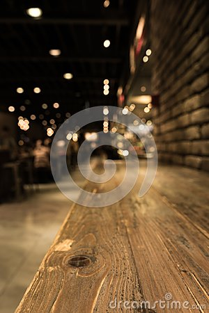 Free Empty Wood Table Top Of Bar With Blur Of Cafe Restaurant In Dark Stock Photography - 99335752