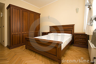 Empty wooden bedroom