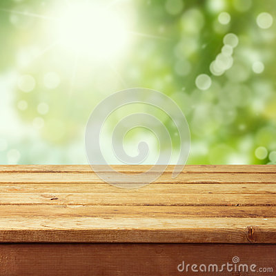 Free Empty Wooden Deck Table With Foliage Bokeh Royalty Free Stock Photo - 29856675