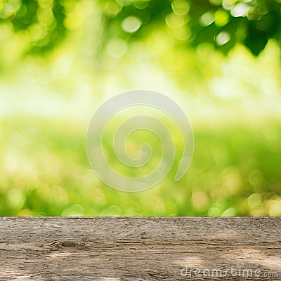 Free Empty Wooden Table In The Garden With Bright Green Background Stock Photos - 32510963