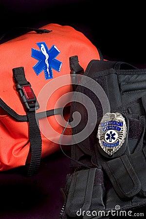 EMT medical bag,  tactical vest and badge
