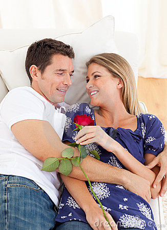 Enamored lovers relaxing on sofa