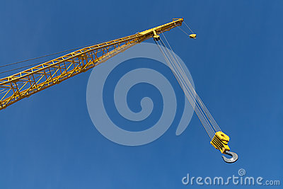 End of Yellow Crane against Blue Sky