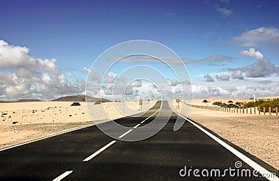 Endless coastal road and sand
