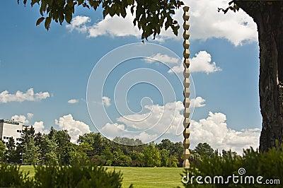 Endless Column Framed by Vegetation Editorial Image