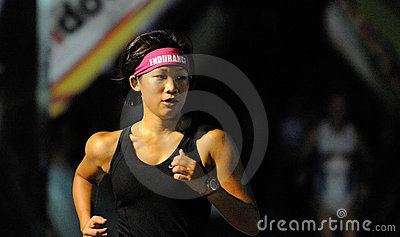 Endurance Head Band on Woman Marathon Runner Editorial Stock Photo