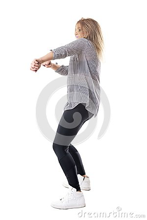 Free Energetic Ecstatic Blonde Woman Dancing. Side View. Royalty Free Stock Image - 108649846