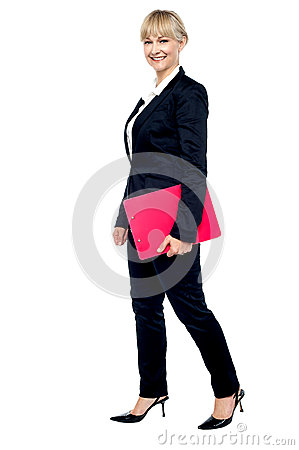 Energetic employee walking with her clipboard