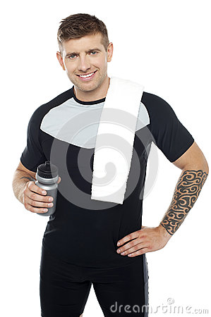 Energetic fit man holding water bottle