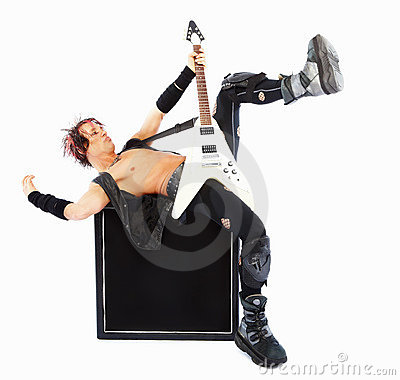 An energetic rockstar bending with a guitar