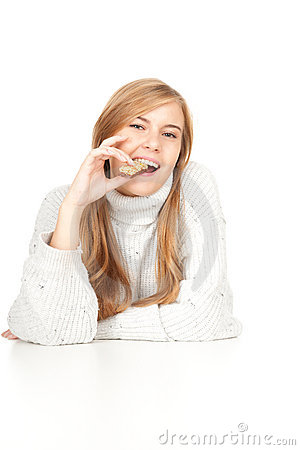 Energy food, young woman eating granola bar