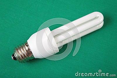 Energy-saving lamp on green