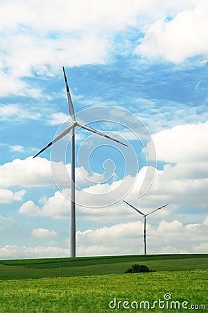 Energy windmills in green summer field