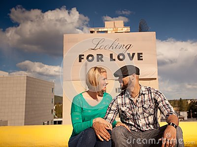 Engaged couple with love sign