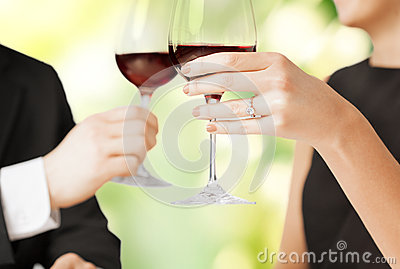 Engaged couple with wine glasses
