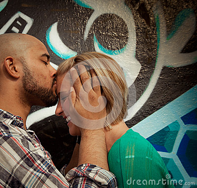 Engaged Young Couple Kissing
