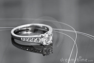 Engagement Ring on a reflective surface