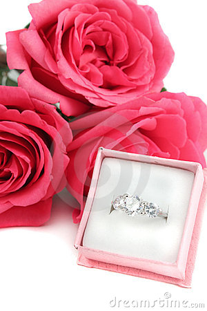Engagement ring and roses