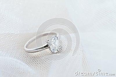 Engagement ring on white veil