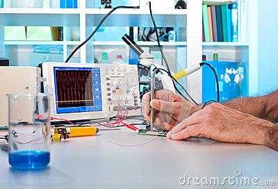 An engeneer tests electronic components