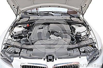 Engine of BMW 335i car - bonnet open position