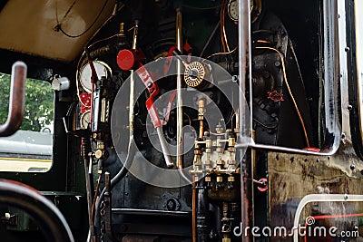 Engine room on steam train, Dartmouth, Devon, United Kingdom, May 24, 2018 Editorial Stock Photo