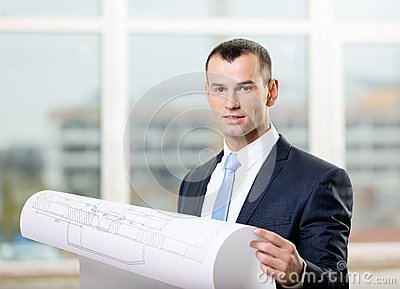 Engineer with blueprint