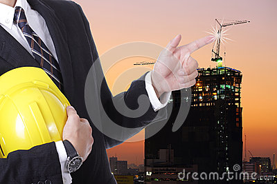 Engineer businessman touching crane