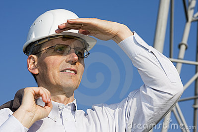 Engineer in front of steel construction