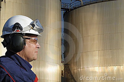 Engineer with fuel towers
