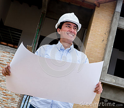 Engineer holding blueprints
