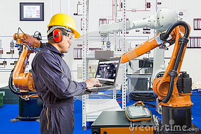 Engineer install and testing industry robotic in manufacturing Stock Photo