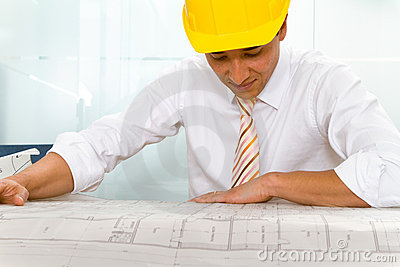 Engineer looking at blueprints