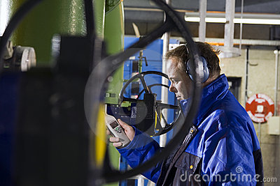 Engineer measuring noise levels