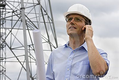 Engineer with mobile phone