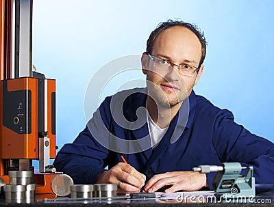 Engineer recording measurement data