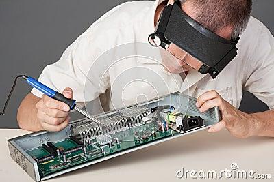 Engineer repairing circuit board