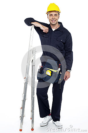 Engineer resting his hands on stepladder