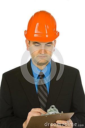 Engineer taking notes