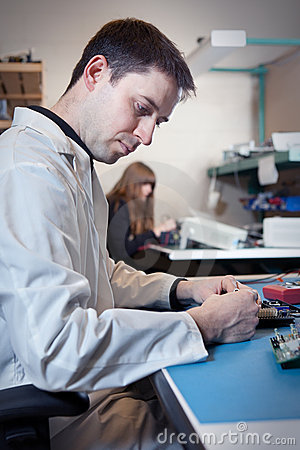 Engineer testing a circuit board assembly